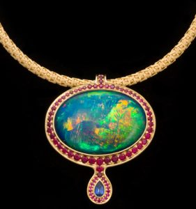 Australian Opal Pendant Surrounded in Rubies with Sapphire Drop